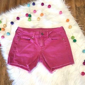 American Eagle fuchsia frayed denim shorts